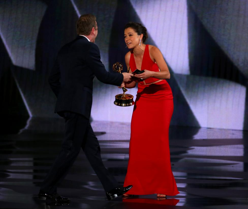 Presenter Sutherland congratulates Maslany after she won the award for Outstanding Lead Actress In A Drama Series at the 68th Primetime Emmy Awards in Los Angeles